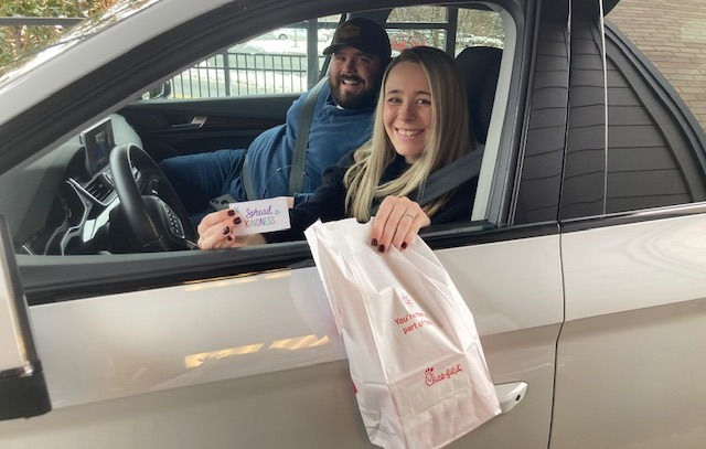 people smiling in drive thru line